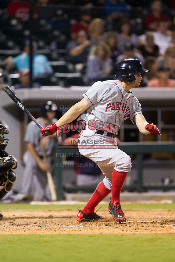 Garin Cecchini (3) of the Pawtucket Red Sox follows through on his swing against the Charlotte Knights at BB&T Ballpark on August 9, 2014 in Charlotte, North Carolina.  The Red Sox defeated the Knights  5-2.  (Brian Westerholt/Four Seam Images)