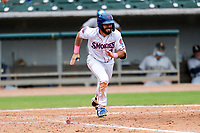 Tennessee Smokies center fielder Connor Myers (9) hustles up the first-base line during the game against the Montgomery Biscuits on May 9, 2021, at Smokies Stadium in Kodak, Tennessee. (Danny Parker/Four Seam Images)