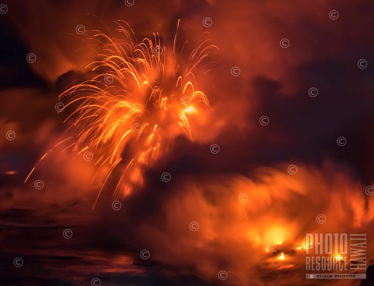 Pele's Fireworks: Giant explosions occur as lava instantly reacts to the cool sea water, Kamokuna, Hawai'i Volcanoes National Park, Big Island.
