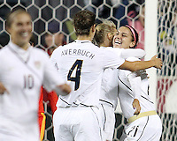 Alex Morgan #21 of the USA WNT is congratulated by Kristine Lilly #13 and Yael Averbuch #4 after scoring her career first goal for the national team to tie the game during an international friendly match against the PRC WNT at PPL Park, on October 6 2010 in Chester, PA. The game ended in a 1-1 tie.