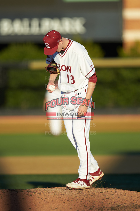 Elon Phoenix starting pitcher George Kirby (13) kicks the dirt in front of the rubber during the game against the Quinnipiac Bobcats at David F. Couch Ballpark on February 24, 2019 in  Winston-Salem, North Carolina. (Brian Westerholt/Four Seam Images)