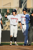 Tyler Sullivan (5) and Seby Zavala (21) of the Kannapolis Intimidators wait to greet teammate Corey Zangari (not pictured) at home plate following his 3-run home run against the Hagerstown Suns at Kannapolis Intimidators Stadium on May 6, 2016 in Kannapolis, North Carolina.  The Intimidators defeated the Suns 5-3.  (Brian Westerholt/Four Seam Images)