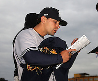 Scranton Wilkes-Barre Yankees infielder Kevin Russo #5 signs autographs before a game against the Rochester Red Wings at Frontier Field on April 12, 2011 in Rochester, New York.  Scranton defeated Rochester 5-3.  Photo By Mike Janes/Four Seam Images
