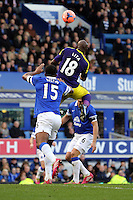 Pictured: Leroy Lita of Swansea (18) heads the ball over Sylvain Distin of Everton. Sunday 16 February 2014<br /> Re: FA Cup, Everton v Swansea City FC at Goodison Park, Liverpool, UK.