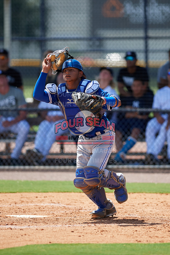 GCL Blue Jays catcher Gabriel Moreno (13) tracks a pop up during a game against the GCL Yankees East on August 2, 2018 at Yankee Complex in Tampa, Florida.  GCL Yankees East defeated GCL Blue Jays 5-4.  (Mike Janes/Four Seam Images)