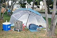 A man sleeps on the ground in the protest area in FDR Park outside of the secure area surrounding the Democratic National Convention at the Wells Fargo Center in Philadelphia, Pennsylvania, on Wed., July 27, 2016.