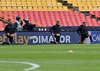 BOGOTA - COLOMBIA, 18-04-2021: Arbitros calientan previo al partido entre Millonarios F. C. y Deportivo Cali de la fecha 19 por la Liga BetPlay DIMAYOR I 2021 jugado en el estadio Nemesio Camacho El Campin de la ciudad de Bogota. / Referees warm up prior a match between Millonarios F. C. and Deportivo Cali of the 19th date for the BetPlay DIMAYOR I 2021 League played at the Nemesio Camacho El Campin Stadium in Bogota city. / Photo: VizzorImage / Luis Ramirez / Staff.