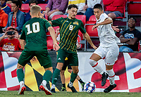 COLLEGE PARK, MD - SEPTEMBER 3: Maryland University defender Kento Abe (2) moves the ball away from George Mason University midfielder Luciano Covella (8) during a game between George Mason University and University of Maryland at Ludwig Field on September 3, 2021 in College Park, Maryland.