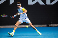 13th February 2021, Melbourne, Victoria, Australia; Filip Krajinovic of Serbia returns the ball during round 3 of the 2021 Australian Open on February 13 2020, at Melbourne Park in Melbourne, Australia.