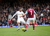 Barclays Premier League, West Ham United (red)V Swansea City Fc (white), Boelyn Ground, 02/02/13<br /> Pictured: Swans defender Angel Rangel takes on Matt Jarvis <br /> Picture by: Ben Wyeth / Athena Picture Agency<br /> info@athena-pictures.com