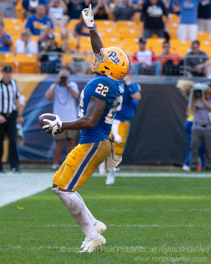 Pitt running back Darrin Hall (22) celebrates his 7-yard touchdown run. The Pitt Panthers defeated the Syracuse Orange 44-37 in overtime at Heinz Field in Pittsburgh, Pennsylvania on October 6, 2018.