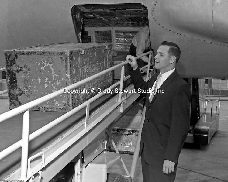 Greater Pittsburgh International Airport:  View of Bob Purkey Sr. of the Cincinnati Reds arriving at the airport for a game with the Pittsburgh Pirates.  The on-location photographic assignment was for United Airlines. The 1960 Cincinnati Reds finished in sixth place in the National League standings, 28 games behind the National League and World Series champion Pittsburgh Pirates!  The highlight for me in this set of images was of the one of Bob Purkey Sr.  I had the opportunity to know Bob Sr while playing high school baseball with his son, Bob Purkey Jr.  For many years, Bob Purkey Sr had a successful insurance business in Bethel Park Pa.