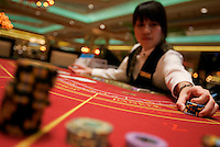 A croupier practices her skills at 'The Venetian Macao Resort and Hotel', Macao, China. With one day to go until it's the resort's grand opening, The Venetian will soon claim the title of the largest casino in the world in terms of gaming tables, with 850 tables and 4,100 slot machines. The venture cost the Las Vegas Sands Corporation Euro 1.757Billion to build.