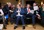 Successful candidates Pat Breen, TD takes a pen from his proposer Gabriel Keating as Joe Carey, TD, chats with Willie Halpin, his proposer, at the Clare Fine Gael selection convention in the Auburn Lodge hotel, Enis. Photograph by John Kelly.