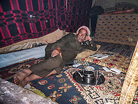 This is my sad father. Me, my father and all my family live in this tent. My Father is very tired, tired from trying to support us a and teach us how to read and write. Thank you. But we are his children we have to take care of him as much as possible. My father suffered a lot to bring us here to this country.