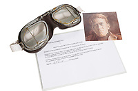 BNPS.co.uk (01202 558833)<br /> Pic: DukesAuctionsBNPS<br /> <br /> Pictured: Also in the sale is a pair of  motorcycle goggles believed to have been owned by Lawrence of Arabia, with an estimate of £1,000.<br /> <br /> A letter questioning the Christianity of author Thomas Hardy that sheds light on his controversial church burial has emerged for sale 93 years later.<br /> <br /> The Dean of Westminster Abbey wrote to Hardy's local vicar looking for reassurance that the literary great could be buried there after opposition about his faith.<br /> <br /> At a time when everyone went to church, Hardy was not considered a 'churchman' and there was no Christian themes in his writing.