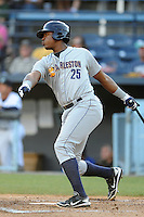 Charleston RiverDogs first baseman Reymond Nunez #25 swings at a pitch during a game against the Asheville Tourists at McCormick Field on May 28, 2012 in Asheville, North Carolina . The Tourists defeated the RiverDogs 15-12. (Tony Farlow/Four Seam Images).