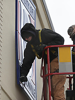 """Sign installers Nate Frihart (center) and Austin Yates install a sign, Thursday, February 11, 2021 at the Bentonville Administrative Services building in Bentonville. A crew from Arkansas Sign and Banner installed the big """"B"""" on the City of Bentonville Administrative Services building. Check out nwaonline.com/210212Daily/ for today's photo gallery. <br /> (NWA Democrat-Gazette/Charlie Kaijo)"""