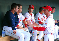 April 28, 2009: Bob Kipper, pitching coach of the Greenville Drive, Class A affiliate of the Boston Red Sox, talks with RHP Casey Kelly, left, and catcher Tim Federowicz, second from left, during a game against the Savannah Sand Gnats at Fluor Field at the West End in Greenville, S.C. Kelly picked up the win. Photo by: Tom Priddy/Four Seam Images
