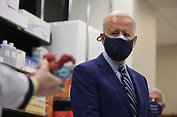 President Joe Biden and Dr. Anthony Fauci at the National Institutes of Health on Thursday, February 11, 2021 in Bethesda, Maryland.<br /> CAP/MPI/RS<br /> ©RS/MPI/Capital Pictures