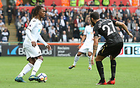 Renato Sanches of Swansea City is challenged by Jesus Gamez of Newcastle United during the Premier League match between Swansea City and Newcastle United at The Liberty Stadium, Swansea, Wales, UK. Sunday 10 September 2017