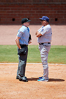 Pensacola Blue Wahoos manager Pat Kelly (33) talks with home plate umpire Matt Winter during a game against the Mobile BayBears on April 26, 2017 at Hank Aaron Stadium in Mobile, Alabama.  Pensacola defeated Mobile 5-3.  (Mike Janes/Four Seam Images)