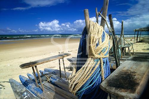 Costa Verde (Coconut coast), Brazil. Jangada log fishing boats on an unspoilt beach; Bahia State.