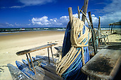 Costa Verde (Coconut coast), Brazil. Jangada log fishing boats on an unspoilt beach; Bahia State.