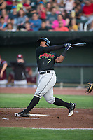 Great Falls Voyagers designated hitter Maiker Feliz (7) follows through on his swing during a Pioneer League game against the Idaho Falls Chukars at Melaleuca Field on August 18, 2018 in Idaho Falls, Idaho. The Idaho Falls Chukars defeated the Great Falls Voyagers by a score of 6-5. (Zachary Lucy/Four Seam Images)