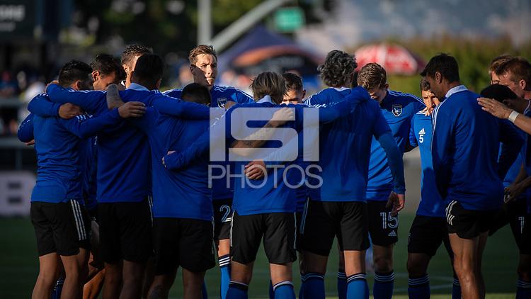 SAN JOSE, CA - MAY 22: Benji Kikanovic #28 of the San Jose Earthquakes huddles with his team mates before a game between San Jose Earthquakes and Sporting Kansas City at PayPal Park on May 22, 2021 in San Jose, California.