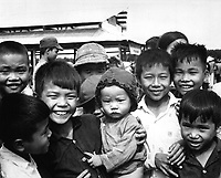 "A new market for ""Tinh Thuong.""  Children gather before the market which was built with assistance from the government of Vietnam and USAID.  (USIA)<br /> EXACT DATE SHOT UNKNOWN<br /> NARA FILE #:  306-MVP-6-9<br /> WAR & CONFLICT BOOK #:  409"