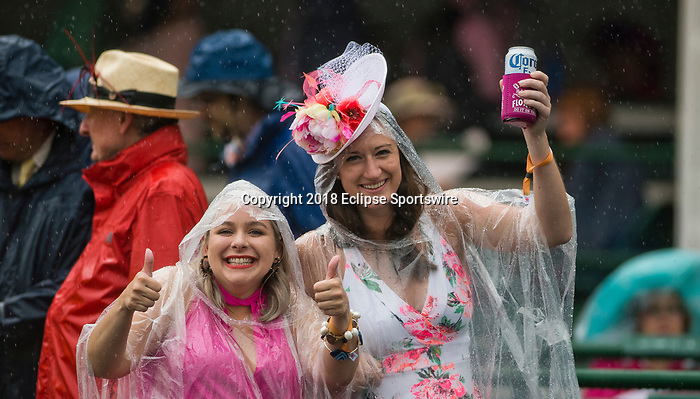 LOUISVILLE, KY - MAY 05: Fans cheer despite the torrential rain on Kentucky Derby Day at Churchill Downs on May 5, 2018 in Louisville, Kentucky. (Photo by Eric Patterson/Eclipse Sportswire/Getty Images)