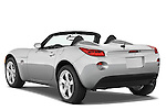 Rear three quarter view of a 2008 Pontiac Solstice with the top down
