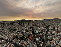 Pictured: Thick smoke caused by a multitude of forest fires, covers the sky over Athens, Greece. Sunday 08 August 2021<br /> Re: Forest fire in northern Evia, Greece.