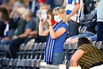 A masked Kilmarnock fan recording ground on her phone. Kilmarnock 2 Ayr United 0, Scottish Championship, August 2nd 2021. Following Kilmarnock's relegation in 2020-21, the first game of the new season is the Ayreshire Derby, the first league match between the teams in 28 years. Due to relaxation of Covid restrictions the match was played in front of a crowd of 3200 Kilmarnock fans. The game was shown live on BBC Scotland.