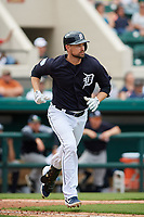 Detroit Tigers shortstop Jordy Mercer (7) runs to first base during a Grapefruit League Spring Training game against the New York Yankees on February 27, 2019 at Publix Field at Joker Marchant Stadium in Lakeland, Florida.  Yankees defeated the Tigers 10-4 as the game was called after the sixth inning due to rain.  (Mike Janes/Four Seam Images)