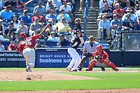 Philadelphia Phillies pitcher Miguel Alfredo Gonzalez (75) delivers a pitch to Caleb Joseph (72) batting in front of catcher Cameron Rupp and umpire Dan Iassogna during a spring training game against the New York Yankees on March 1, 2014 at Steinbrenner Field in Tampa, Florida.  New York defeated Philadelphia 4-0.  (Mike Janes/Four Seam Images)