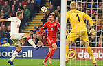 Cardiff - Wales - UK - 16th November 2018 - UEFA Nations League 2019 :<br />Wales v Denmark at the Cardiff City Stadium :<br />Aaron Ramsey of Wales heads the ball into the Denmark box in the second half despite the attentions of Henrik Dalsgaard of Denmark.