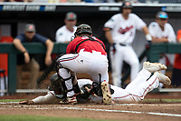 Auburn Tigers shortstop Will Holland (17) is tagged out by Louisville Cardinals catcher Henry Davis (32) at home during Game 7 of the NCAA College World Series on June 18, 2019 at TD Ameritrade Park in Omaha, Nebraska. Louisville defeated Auburn 5-3. (Andrew Woolley/Four Seam Images)