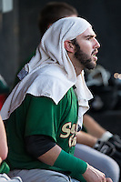 Savannah Sand Gnats catcher Tomas Nido (7) tries to keep cool between innings with a wet towel on his head during the game against the Hickory Crawdads at L.P. Frans Stadium on June 15, 2015 in Hickory, North Carolina.  The Crawdads defeated the Sand Gnats 4-1.  (Brian Westerholt/Four Seam Images)