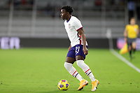 ORLANDO CITY, FL - JANUARY 31: George Bello #21 of the United States moves with the ball during a game between Trinidad and Tobago and USMNT at Exploria stadium on January 31, 2021 in Orlando City, Florida.