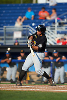 West Virginia Black Bears first baseman Carlos Munoz (56) hits a home run during a game against the Batavia Muckdogs on August 30, 2015 at Dwyer Stadium in Batavia, New York.  Batavia defeated West Virginia 8-5.  (Mike Janes/Four Seam Images)