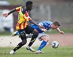 St Johnstone v Partick Thistle...29.03.14    SPFL<br /> Prince Buaben fouls Chris Millar<br /> Picture by Graeme Hart.<br /> Copyright Perthshire Picture Agency<br /> Tel: 01738 623350  Mobile: 07990 594431