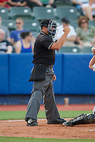 Home plate umpire Tyler Olson makes a strike call during the New York Penn League game between the Brooklyn Cyclones and the Hudson Valley Renegades at Dutchess Stadium on June 18, 2014 in Wappingers Falls, New York.  The Cyclones defeated the Renegades 4-3 in 10 innings.  (Brian Westerholt/Four Seam Images)