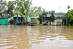 The monsoon season in Vietnam's Mekong Delta runs from May to November. Record floods this year have left many homes along the Hau River south of Can Tho practically inundated. Sept. 30, 2011.