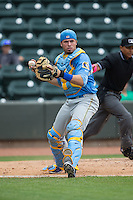 Myrtle Beach Pelicans catcher Victor Caratini (17) makes a throw to first base after a dropped third strike against the Winston-Salem Dash at BB&T Ballpark on May 10, 2015 in Winston-Salem, North Carolina.  The Pelicans defeated the Dash 4-3.  (Brian Westerholt/Four Seam Images)
