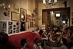 """The House of Memory of Felicia and Peppino Impastato in Cinisi, during a open meeting to talk about the mafia. The house collects testimonies of the life of Peppino and describes itself as an outpost of resistance against the Mafia. It was from this house that Impastato counted the """"cento passi"""" a """"hundred steps"""" distance from the residence of the local boss Gaetano Badalamenti, known as """"Don Tano"""". / La Casa della Memoria di Felicia e Peppino Impastato a Cinisi durante un incontro aperto per parlare di mafia. La casa raccoglie testimonianze della vita di Peppino e si autodefinisce un avamposto della resistenza contro il potere e la mafia. E' da qui che Impastato contava """"i cento passi"""" dalla casa di don Tano."""