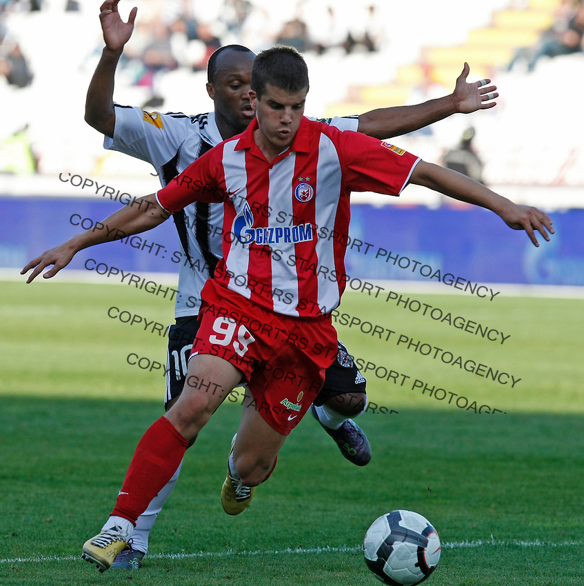 Red Star Belgrade Andrija Kaludjerovic, infront, in action against, Almami da Silva Moreira of Partizan Belgrade, during the Serbian League soccer match in Belgrade, Serbia, Saturday, October  24, 2010. (Srdjan Stevanovic/Starsportphoto.com)