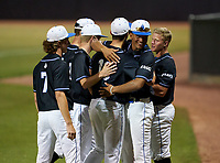 IMG Academy Ascenders pitcher Jackson Ferris (10) hugs Davion Hickson during a game against the Canterbury Cougars on April 21, 2021 at IMG Academy in Bradenton, Florida.  (Mike Janes/Four Seam Images)
