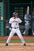 Kenny Towns (9) of the Virginia Cavaliers at bat against the Hartford Hawks at The Ripken Experience on February 27, 2015 in Myrtle Beach, South Carolina.  The Cavaliers defeated the Hawks 5-1.  (Brian Westerholt/Four Seam Images)